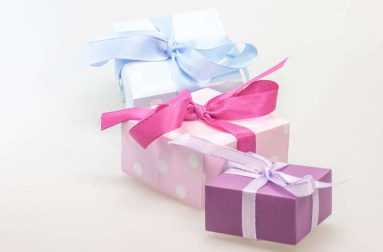 wrapped blue, pink and violet gift boxes